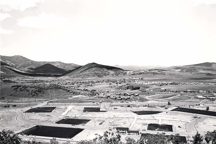 Looking North from Masonic Hill toward Quarry Mountain. In foreground, new parking lots on land between West Sidewinder Drive and State Highway 248, 1986